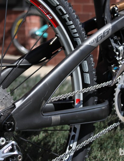 The rear derailleur cable is routed internally through the carbon rear triangle