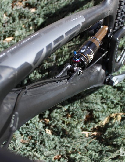 Molded carbon shock mounts on the down tube