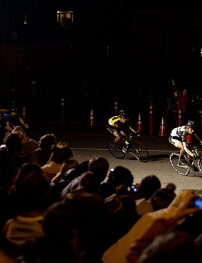 A group of chase riders dive through one of the more well-lit corners on the Red Hook course