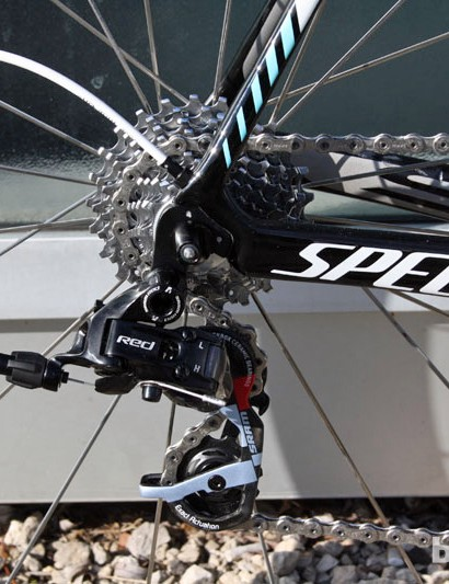The rear derailleur cable is internally routed on the Specialized S-Works Tarmac SL4. This older SRAM Red rear derailleur has since been replaced with the newer version