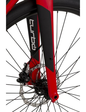 The Specialized Turbo has a custom alloy fork with tapered steerer and 15mm through-axle