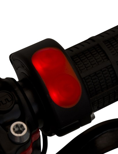 The minimalist power control emits a subtle red glow
