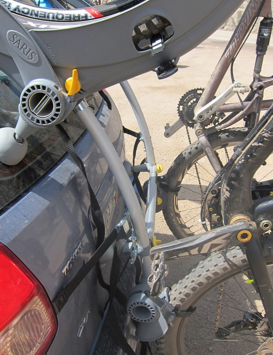 Both the upper and lower wheel mounts have quick-release ratchet straps to secure the bike