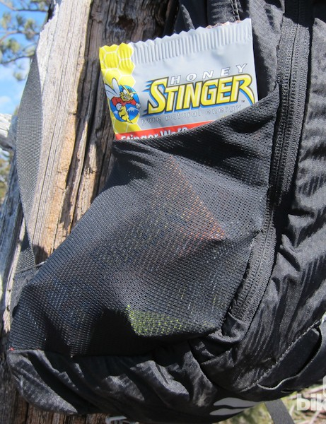 Osprey's stretchy mesh side pockets are perfect for storing food and located low enough to be accessible while riding