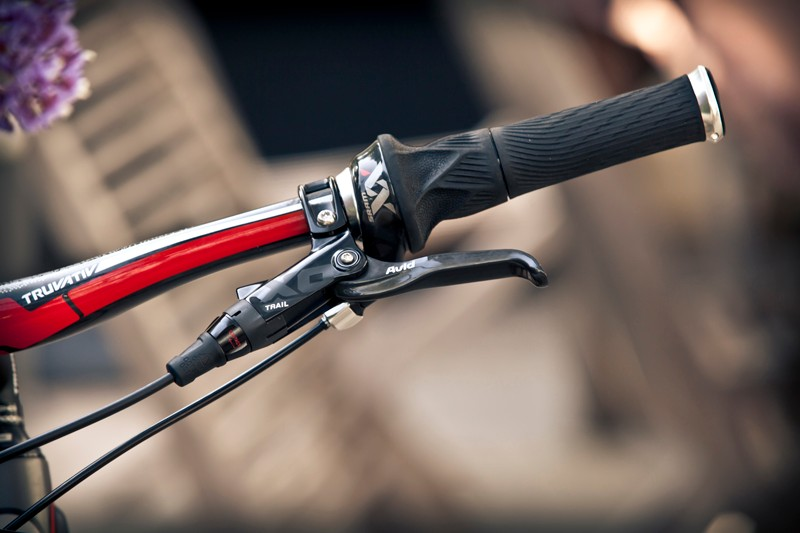 The new SRAM Grip Shift X0 shifters will come with standard cables and housing, and aluminum covers, but the weight is identical to XX. They're significantly cheaper, too