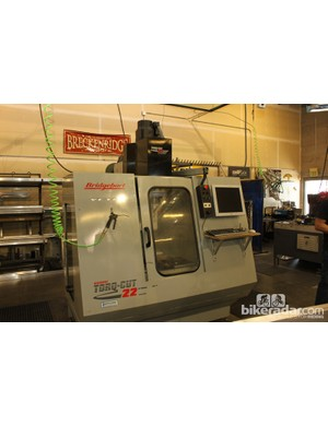 The focal point of the shop is the Bridgeport CNC machine