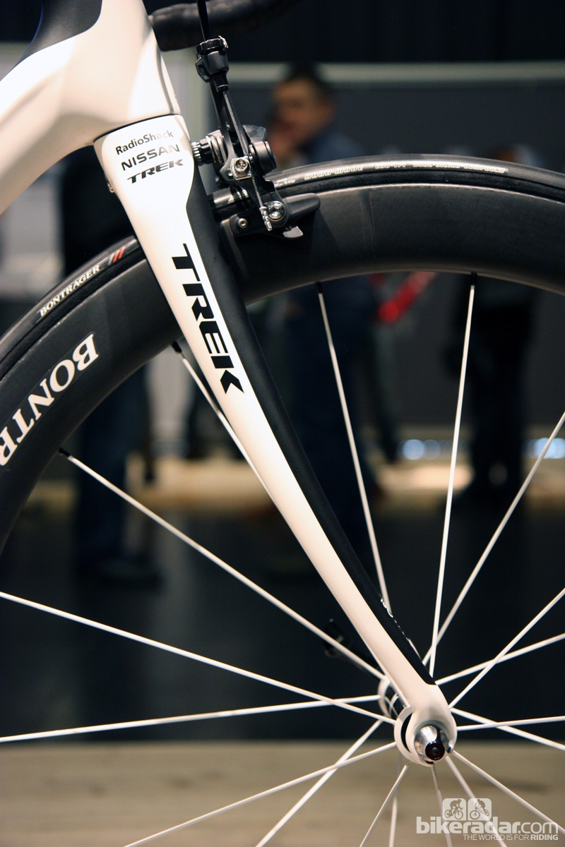 Domane fork blades are radically splayed forward to help smooth the ride out front. Actual rakes are less extreme than appearances would suggest but they're still 48mm or 53mm depending on size. Combined with the slacker head tube angle, the result is a longer front center for stability but steering that's still appropriately quick