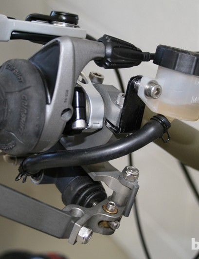 A custom MotoGP thumb lever is used to operate the rear disc brake