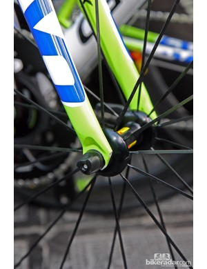 Trek built extra raked-out fork blades offset by rear-facing dropouts into the new Domane but Cannondale did a similar thing with its SuperSix Evo, too. Also note the sleek aluminum hub shell and bladed stainless steel spokes on the new Mavic carbon tubular wheel.