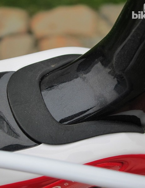 A rubber seal is meant to protect the IsoSpeed bearings and axle from weather but it's really more of a dust cover