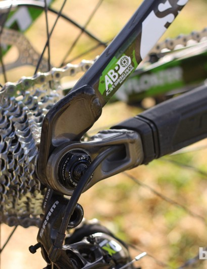 The rear derailleur cable and housing routes through the driveside chainstay