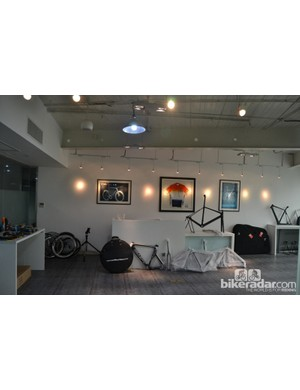 The office's showroom-cum-workshop currently houses some covered 2013 bikes and a couple of nude carbon prototypes. The framed picture on the left is from the 2011 Aeronaut TT bike's appearance in Procycling magazine