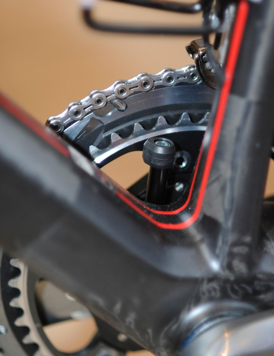 The novel integrated chain catcher is anchored in the bottom bracket shell and features interchangeable bits for use with standard, compact, and triple cranks