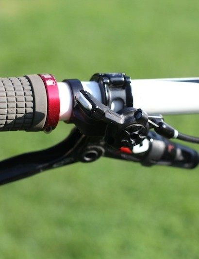 Avid X0 brakes and Aaron Chase signature grips from Lizard skin are on the bars