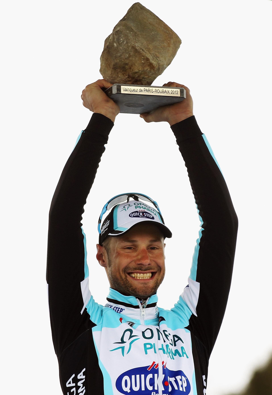 Boonen lifts the famous Paris-Roubaix trophy for a fourth time
