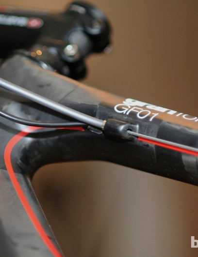 Wires for electronic drivetrains enter the frame in the top tube, just ahead of the brake housing stop