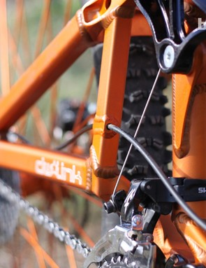 Through-frame routing for the rear derailleur cable