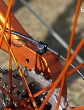 The rear derailleur cable gets a no-zip-tie fitting too