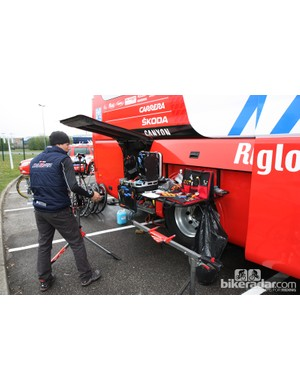 A small table pulls out from the side of the Katusha team bus for mechanics