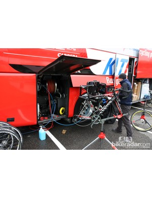 Compressed air and water hoses are kept on a reel in one of the Katusha team truck compartments