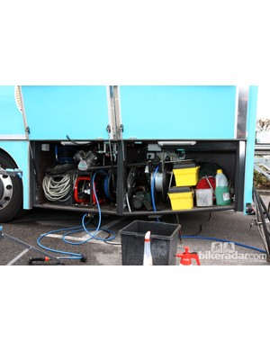 Team trucks have lots of room for storage. Tucked away in this Astana vehicle are a compressor, various hoses and lots of cleaning supplies