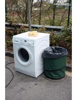 Astana ran yet another washer outside in the parking lot. Teams produce a lot of dirty clothes