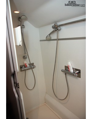 The Astana team bus is equipped with a double shower stall so riders can get cleaned up even before they arrive back at the hotel after a race. Two riders are meant to be in there at once so teammates must clearly be comfortable with each other