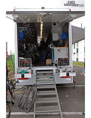The inside of the GreenEDGE team truck. Note the lights mounted to the flip-up rear door. Mechanics work long hours