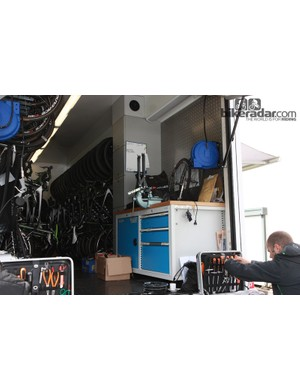 The workbench inside the GreenEDGE team truck provides a base for a vise and truing stand. Drawers for tools lock to keep them in place while the truck is in motion