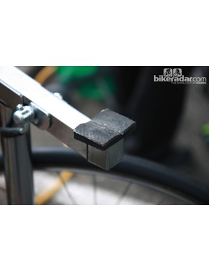 This GreenEDGE repair stand is customized with a couple of scraps from an old tubular tire to pad the bottom bracket shell