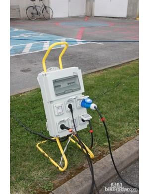 Power and water are critical elements for team mechanics. This portable surge protector allows several team vehicles to operate out of a single outlet
