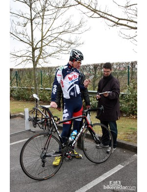 A fan gathers an autograph at the Lotto-Belisol truck just as the team were returning from a recon ride