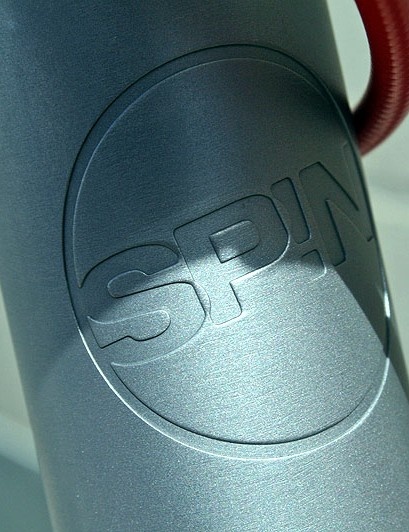 Spin's head tube logo is machined in rather than stuck on