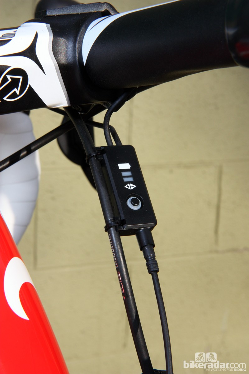 This little box and its two LEDs serve as both the battery charge indicator and the switch for ride vs setup mode