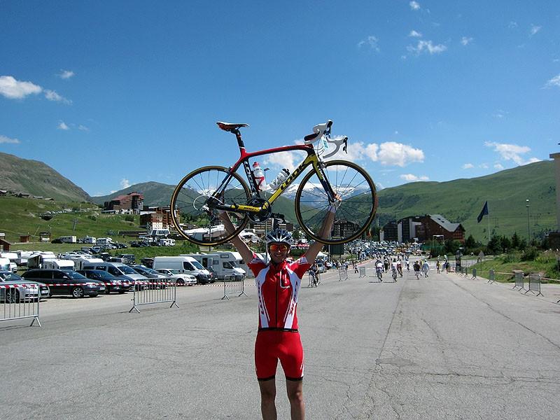 Procycling's Jamie Wilkins atop Alpe d'Huez having conquered last year's Etape du Tour Act 1