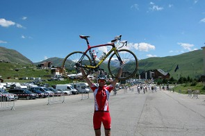 Procycling's Jamie Wilkins atop Alpe d'Huez having conquered last year's Etape du Tour Act 1