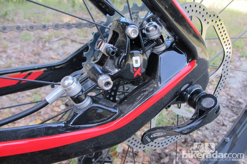The rear brake caliper nestles between the seat- and chainstay