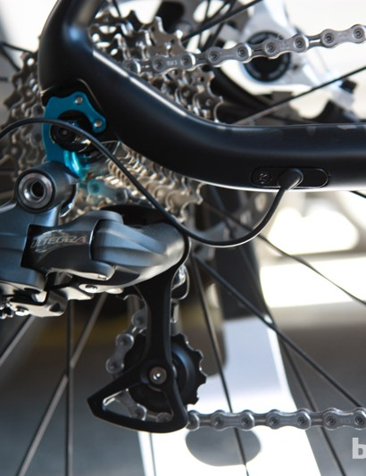 The rear derailleur mounts to a replaceable hanger