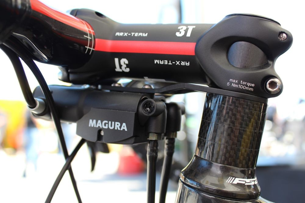 Magura's new converter mounts neatly on the steerer tube and transforms mechanical cable pull into hydraulic push