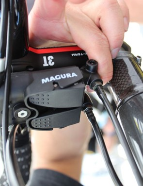 To close the RT8 caliper, you just press on the rear of the unit where the hydraulic line enters the converter