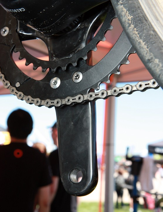 The chainrings on Praxis Works' new Turn carbon fiber crankset are actually one piece of aluminum, attached to the stout arms and chainring by five bolts