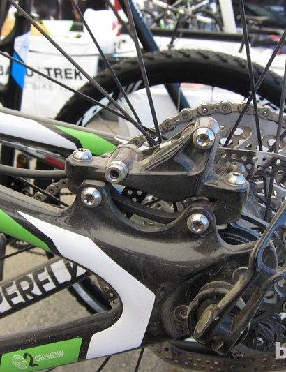 The side of the caliper is smaller and of a different design to the current XX unit; Batty's Superfly hardtail is also outfitted with a 142x12mm Maxle through-axle