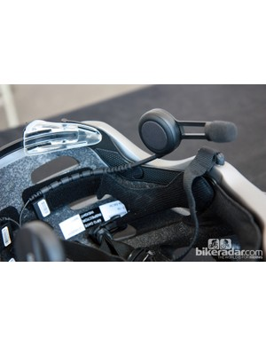 The Cardo BK-1 is easily mounted with stick-on Velcro strips. The stalks can be bent as needed and secured either inside the helmet as shown or along the lower edge depending on fit
