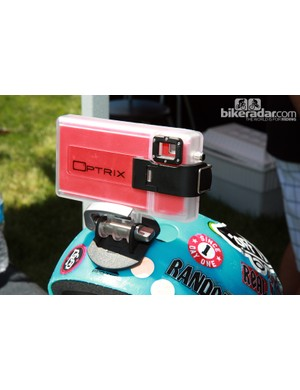 Optrix offer a tough video camera case and mounting system for iPhone 4 and 4S users that retails for US$89. The free video app is especially sweet, too, offering the ability to display GPS speed and course data that updates along with the video