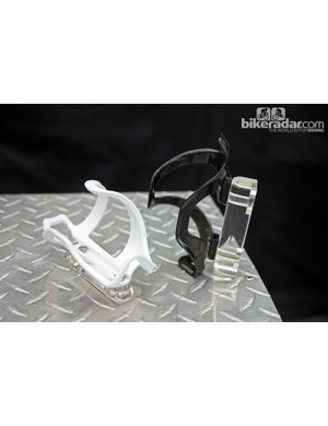 Lezyne add two side-loader cages for 2013: the Flow Cage SL at left (US$10, 48g) and the Carbon Cage SL at right ($60, 35g). Both will be offered in left-hand or right-hand versions