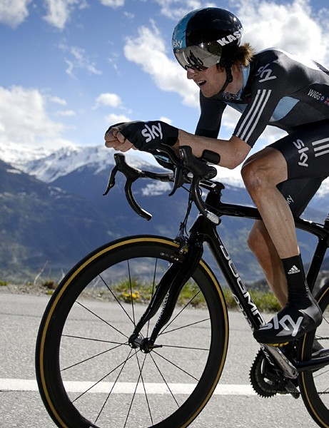 Brad Wiggins rides to victory in the final time trial of the Tour de Romandie