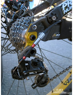 The rear derailleur is attached to a stout hanger on the Nukeproof Rook's through-axle rear end. Check out the prototype