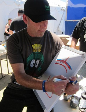 Waldron used his white board to explain Kali's composite fusion and low-density foam design philosophies. Instead of using internal cages they use dual-density designs that put the softest foam possible next to a rider's head to lower G-force on impact. The process takes more engineering, but Kali say it makes them safer