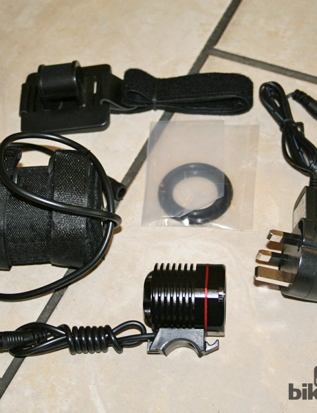 The V2 bundle includes the light, battery, charger, helmet mount and two different size O-rings for handlebar mounting