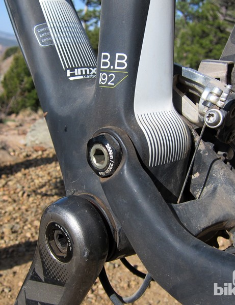 The main pivot rotates on a big aluminum axle and cartridge bearings but we found it to be placed too low for good pedaling efficiency
